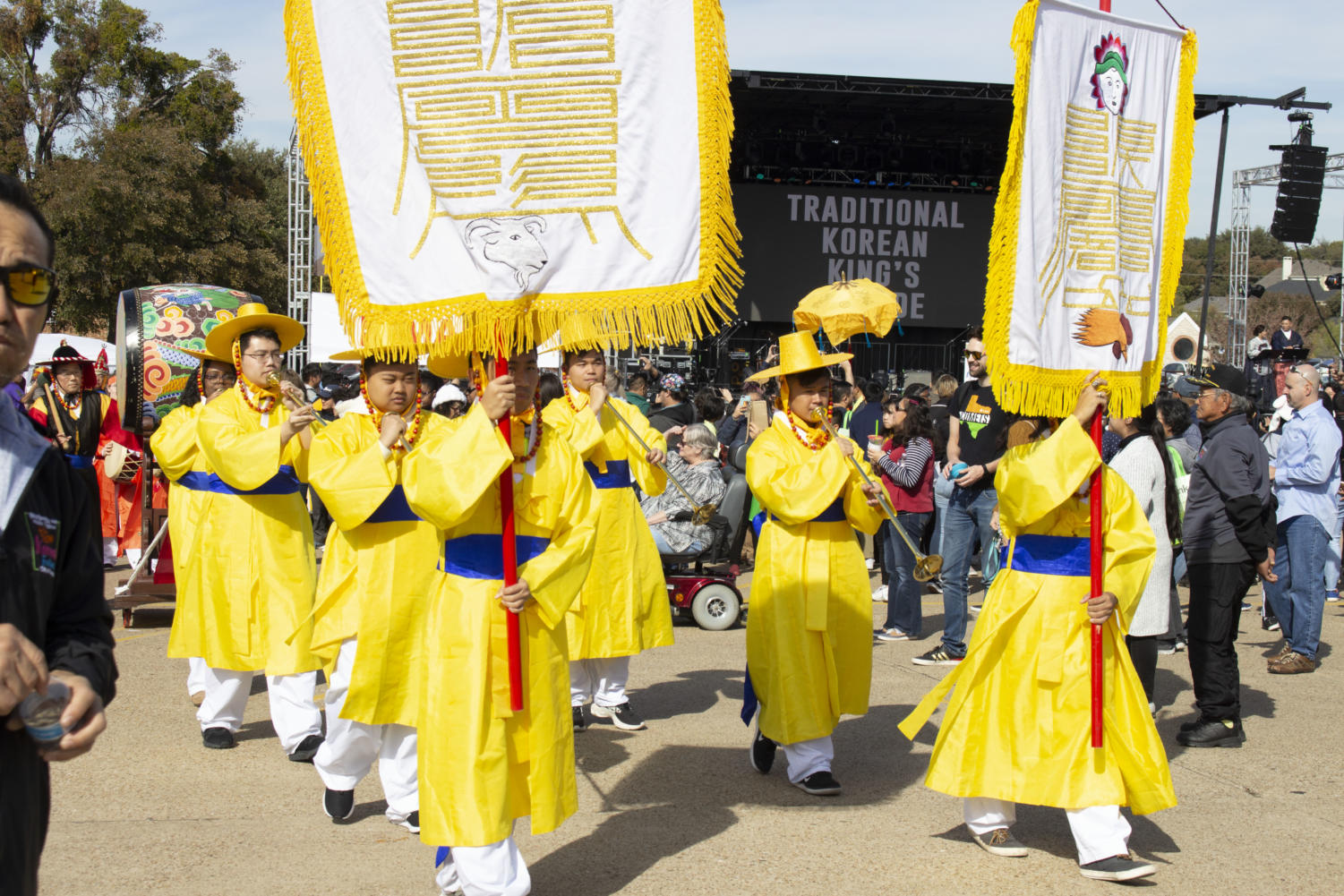 Volunteers at the Korean Festival perform a Traditional King's Korean Parade with drums, horns and customary closing on Saturday at Carrollton Asian Town Center. The festival celebrates Korean culture with music, food, ceremonies and various vendors.