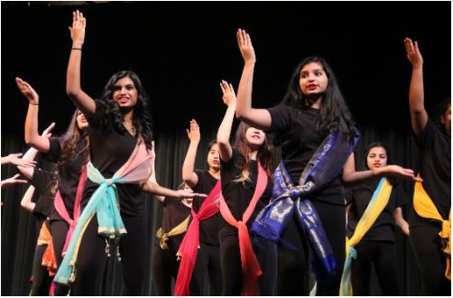 Coppell High School Respira freshman Mihira Kada and sophomore Sreeja Mudumby dance during their performance of Jai Ho. Coppell High School's Respira hosted its annual Respira Desert Show on Friday in the CHS Auditorium. Photo by Ava Mora.
