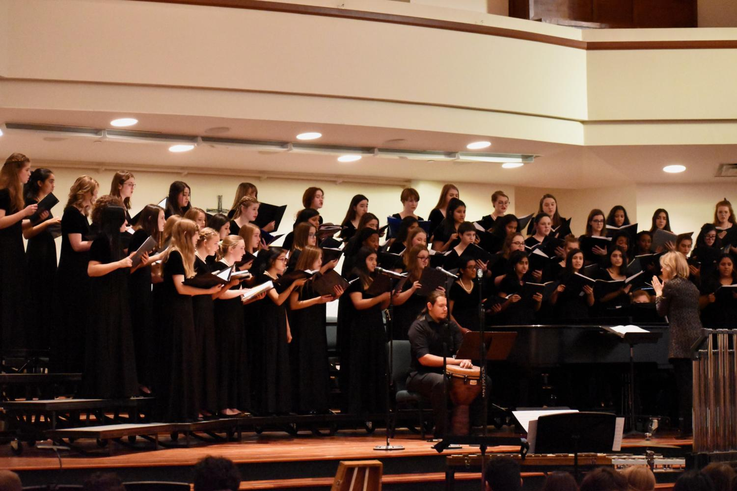 """The TMEA Region 31 Treble choir performs a piece called """"The Composition of a Kiss"""" by Padworski during the 2019 All Region Honor Choir concert on Saturday at the Grapevine First United Methodist Church. Parents and friends come to watch and enjoy an evening full of a variety of music sung by each choir."""