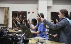 Travel with the drumline on dual competition day