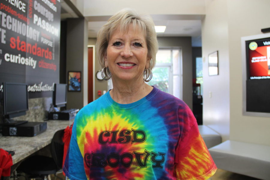 "Coppell High School special education teacher Jolynn Kelly shows her CISD spirit by participating in ""Tie Dye Tuesday"" at Turning Point, a program for students who need alternative pathways to graduation at Victory Place @ Coppell. Kelly has worked in Coppell ISD for 37 years and helped develop Turning Point."