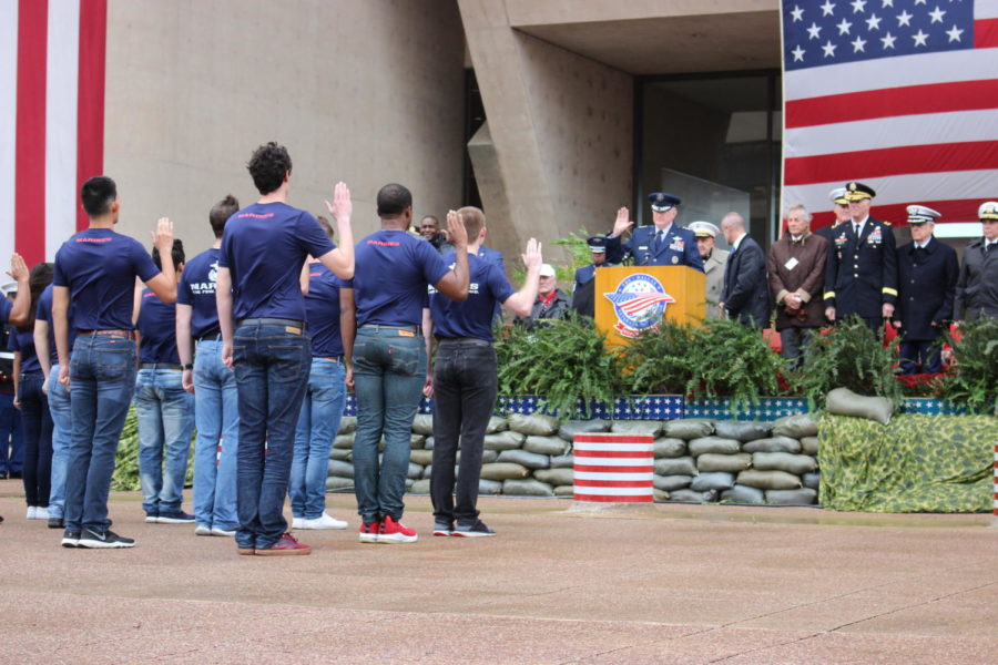 Marine students go through the Oath of Enlistment to officially announce their acceptance in the U.S. Marines. The parade was held on Nov. 11 in Downtown Dallas to commemorate the soldiers who put their lives on the line to protect the freedoms that many Americans abide by today.