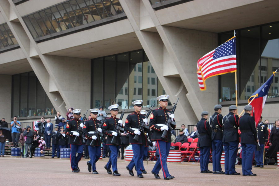 The 2nd Battalion, 14th Marines conduct the Rifle Salute during The Greater Dallas Veterans Day Parade. The parade was held on Nov. 11 in Downtown Dallas, to commemorate the soldiers who put their lives on the line to protect the freedoms that many Americans abide by today.