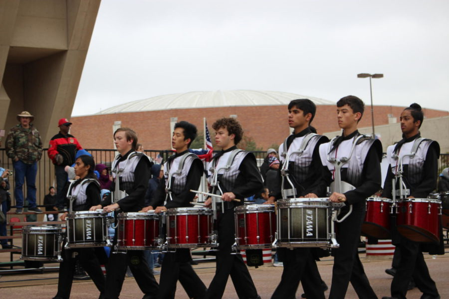 The Coppell High School drumline performs at The Greater Dallas Veterans Day Parade. The parade was held on Nov. 11 in Downtown Dallas to commemorate the soldiers who put their lives on the line to protect the freedoms that many Americans abide by today.