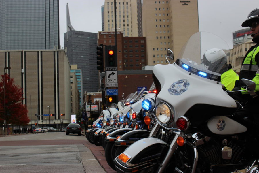 The Dallas Police block a portion of the street with their motorcycles to allow the flow for the parade. The parade was held on Nov. 11 in Downtown Dallas to commemorate the soldiers who put their lives on the line to protect the freedoms that many Americans abide by today.