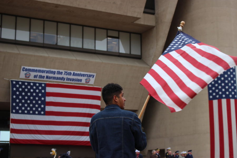 An attendee waves the American flag during The Greater Dallas Veterans Day Parade. The parade was held on Nov. 11 in Downtown Dallas to commemorate the soldiers who put their lives on the line to protect the freedoms that many Americans abide by today.