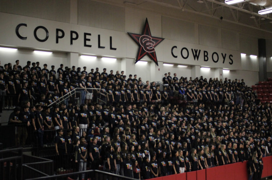 Coppell High School seniors stand under the Coppell Cowboys logo, participating in the tradition known as the senior panorama today in the CHS Arena. Every single student in the crowd sports this year's senior T-shirt.