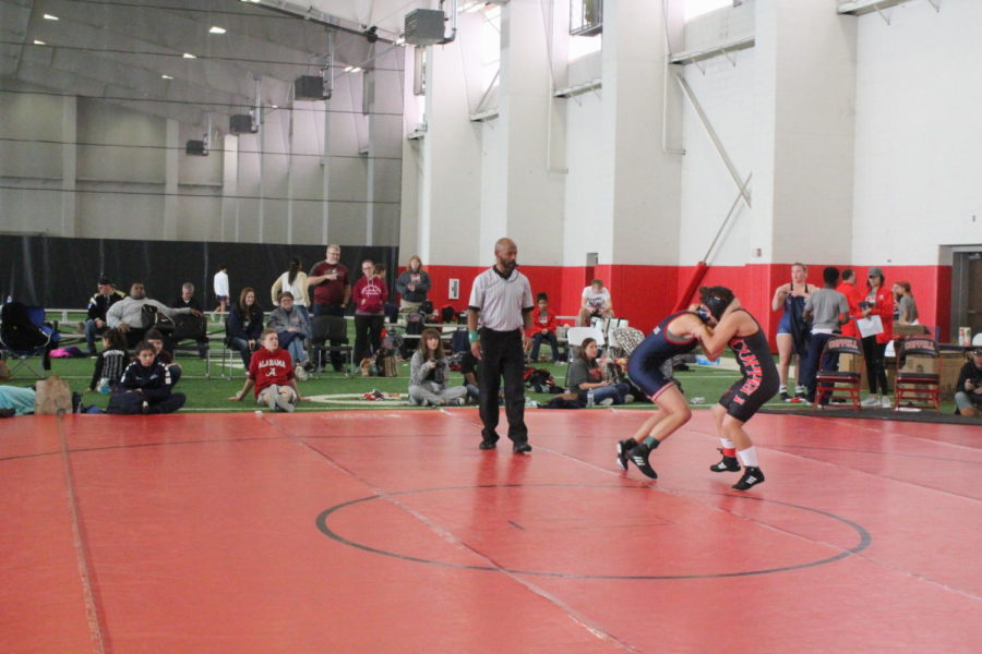 Coppell sophomore Hazel Salinas wrestles Allen in a bout Saturday. The Coppell wrestling team competed in the Coppell Round-Up pre-season tournament on Saturday in the CHS fieldhouse, placing first by winning a majority of the bouts.