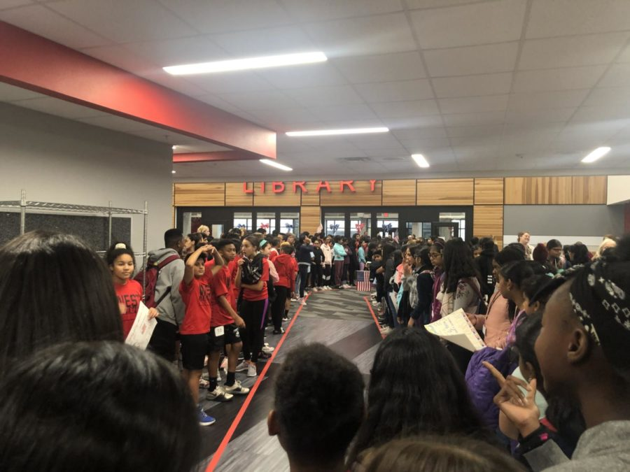 Coppell Middle School West students wait outside the library to greet local veterans at the 25th annual Veterans Day event on Friday. The event was hosted by CMSW in order to honor and thank veterans who put their lives on the line to fight in WWII, Vietnam, Afghanistan and other wars.
