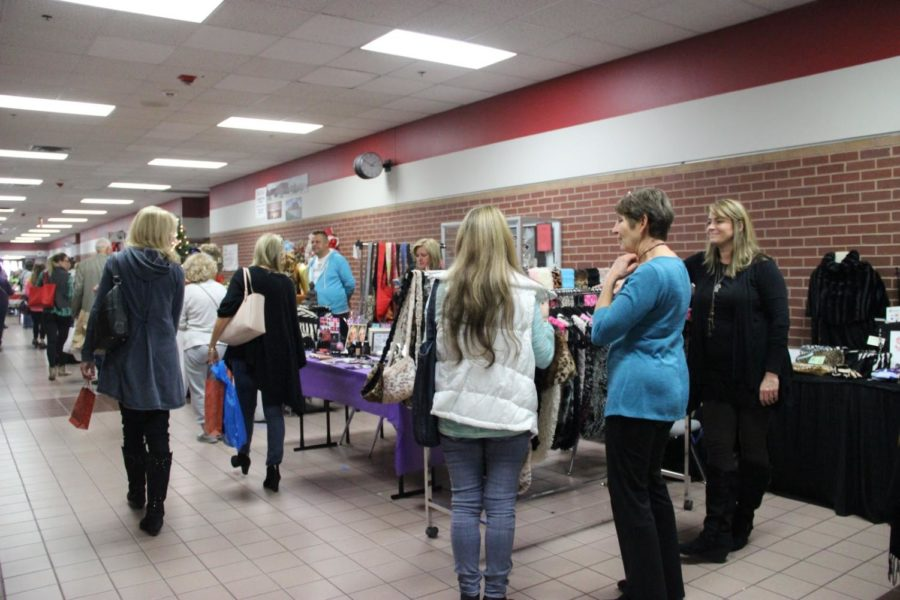 Attendees browse vendors' booths at the 2015 Coppell High School Holiday House. This year's Holiday House is Sunday from 10 a.m. to 4 p.m. and will include more than 100 local vendors.