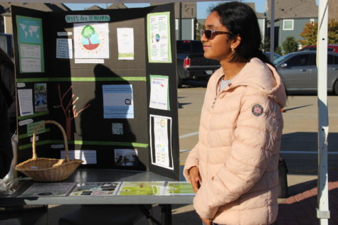 Coppell High School junior Swetha Tandri promotes her nonprofit organization Trees for Tomorrow at the Coppell Farmers Market on Nov. 16. Tandri promotes the use Ecosia over Google since it is a search engine that plants trees with a portion of the profits from advertisements.