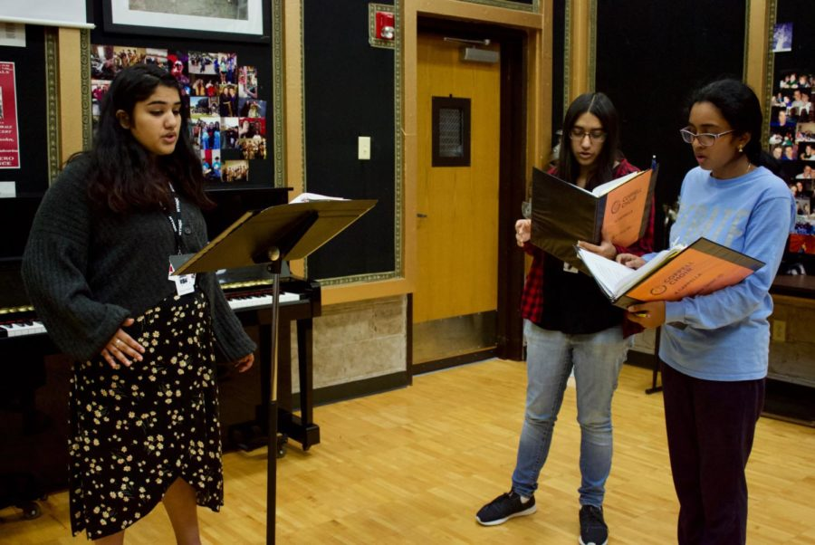 New Tech High @ Coppell senior Manasa Velamuri, Coppell High School senior Amrita Ghose and junior Swetha Tandri sing in a sectional during Aaron Coronado's eighth period choir chorale class on Tuesday. Coppell had 29 singers individually compete at the Texas Music Educators Association (TMEA) Region 31 auditions at L.D. Bell High School on Sept. 26, and 15 made it through to the Pre-Area stage on Nov. 19 at Carroll Senior High School in Southlake. Photo by Mari Pletta