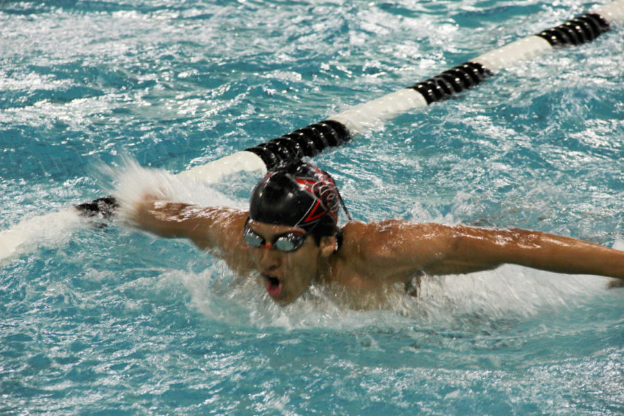 Coppell+junior+swimmer+Hector+Romero+practices+butterfly+strokes+at+the+YMCA+for+swim+practice+on+Oct.+28.+In+addition+to+swimming%2C+Romero+also+plays+the+clarinet+in+the+CHS+band+and+is+in+the+International+Baccalaureate+program+at+CHS.
