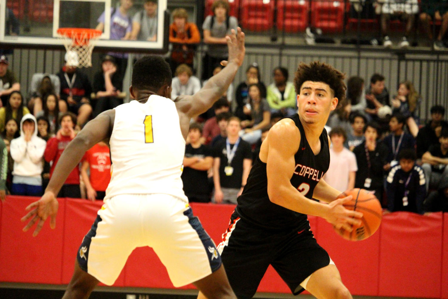 Coppell senior guard Brandon Taylor prepares to bounce pass to his teammate against Lamar in the CHS Arena during the 2019 Classic Chevrolet Coppell Showcase on Thursday. The Cowboys play Rockwall in the main gym tomorrow at 12 p.m.