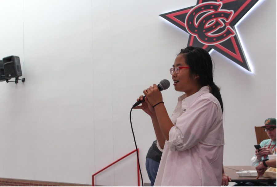 Coppell High School junior class president Lily Lee announces  homecoming dance ticket sales in the cafeteria during B lunch on Oct. 23.