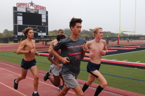 Coppell junior Evan Caswell warms up with his teammates at cross country practice on Tuesday morning on the Buddy Echols Field track. Caswell holds school records in two cross country events and is chasing his third record in a track event.