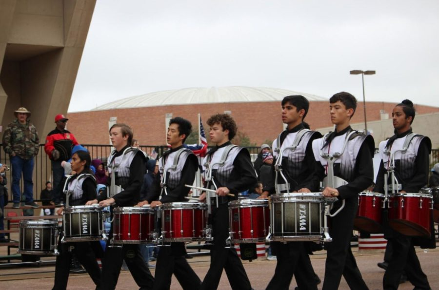 The Coppell High School drumline performs at The Greater Dallas Veterans Day Parade. The parade was held on Monday in Downtown Dallas to commemorate the soldiers who put their lives on the line to protect the freedoms that many Americans abide by today.