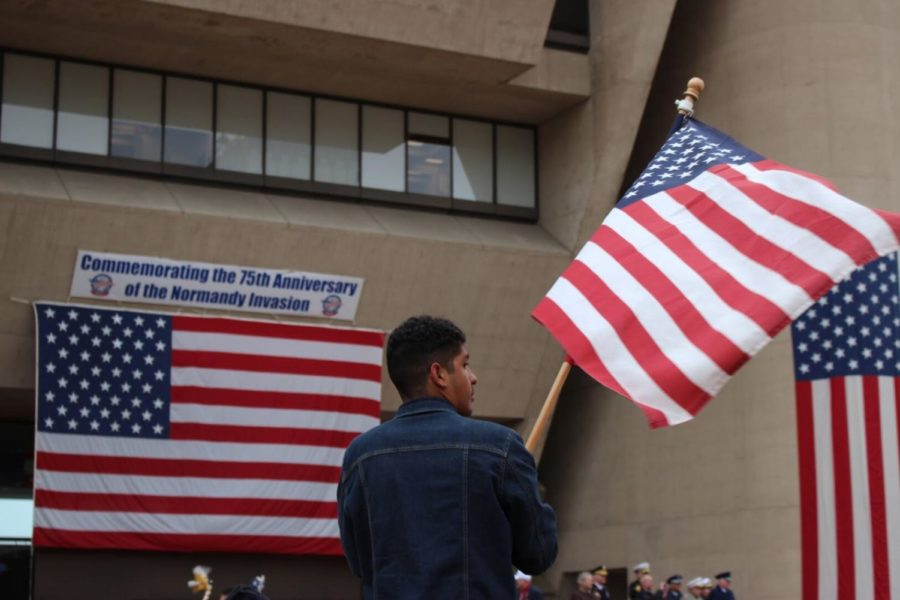 An attendee waves the American flag during The Greater Dallas Veterans Day Parade. The parade was held on Monday in Downtown Dallas to commemorate the soldiers who put their lives on the line to protect the freedoms that many Americans abide by today.