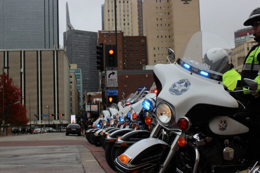 The Dallas Police block a portion of the street with their motorcycles to allow the flow for the parade. The parade was held on Monday in Downtown Dallas to commemorate the soldiers who put their lives on the line to protect the freedoms that many Americans abide by today.