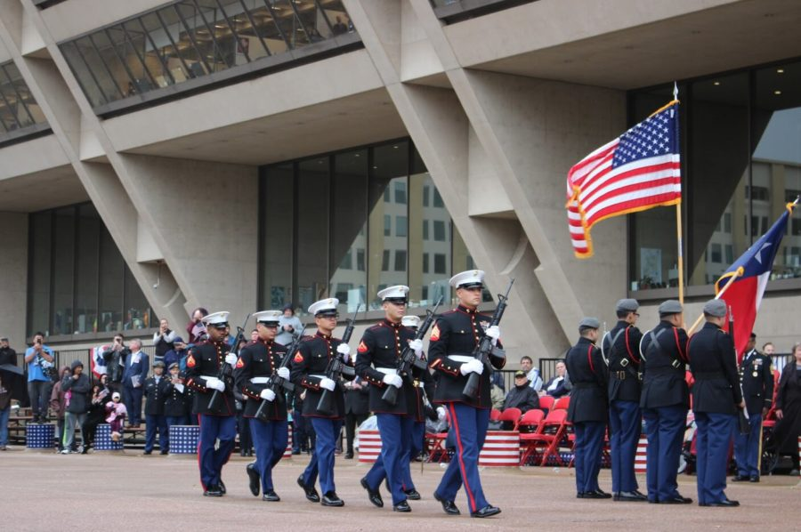 The 2nd Battalion, 14th Marines conduct the Rifle Salute during The Greater Dallas Veterans Day Parade. The parade was held on Monday in Downtown Dallas, to commemorate the soldiers who put their lives on the line to protect the freedoms that many Americans abide by today.