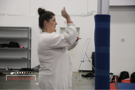 Coppell cheerleading coach Alexis Irons reviews the correct movement for basketball chants at the Spirit of Texas gym during eighth period on Wednesday. Irons taught at Coppell High School three years ago and has returned as an English lll teacher as well as cheerleading coach.