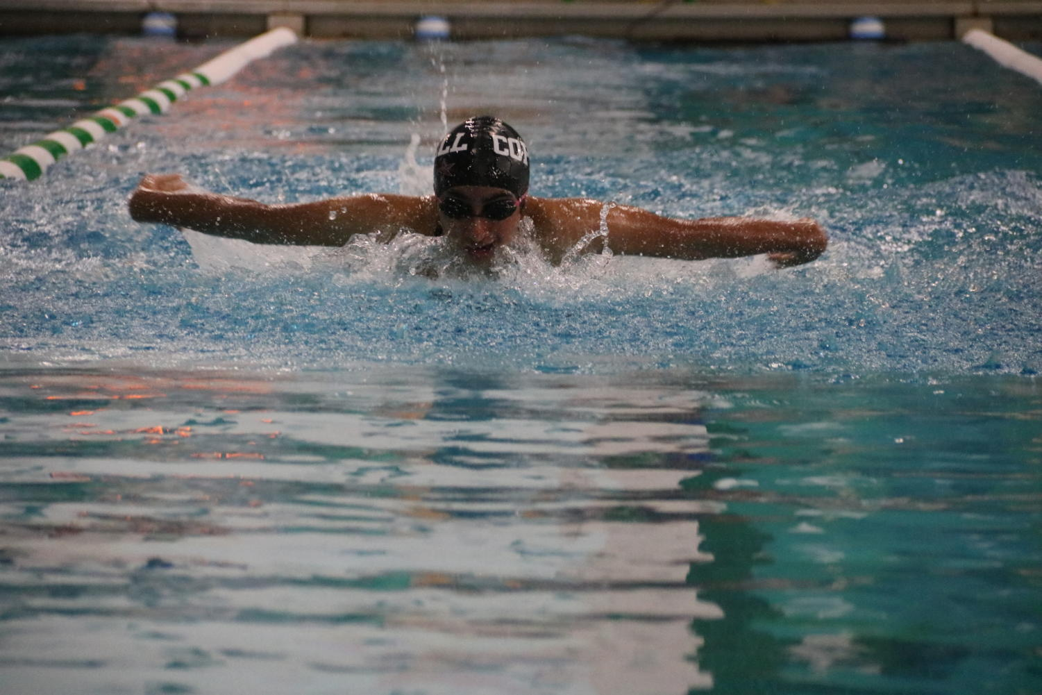 Coppell sophomore swimmer Krithi Meduri competes in the Dragon Hunt Invitational at the Carroll Natatorium in Southlake on Oct. 17. The Vaquero Battle meet will be held tomorrow at 4:30 p.m. in the Coppell YMCA. Photo by Tracy Tran.