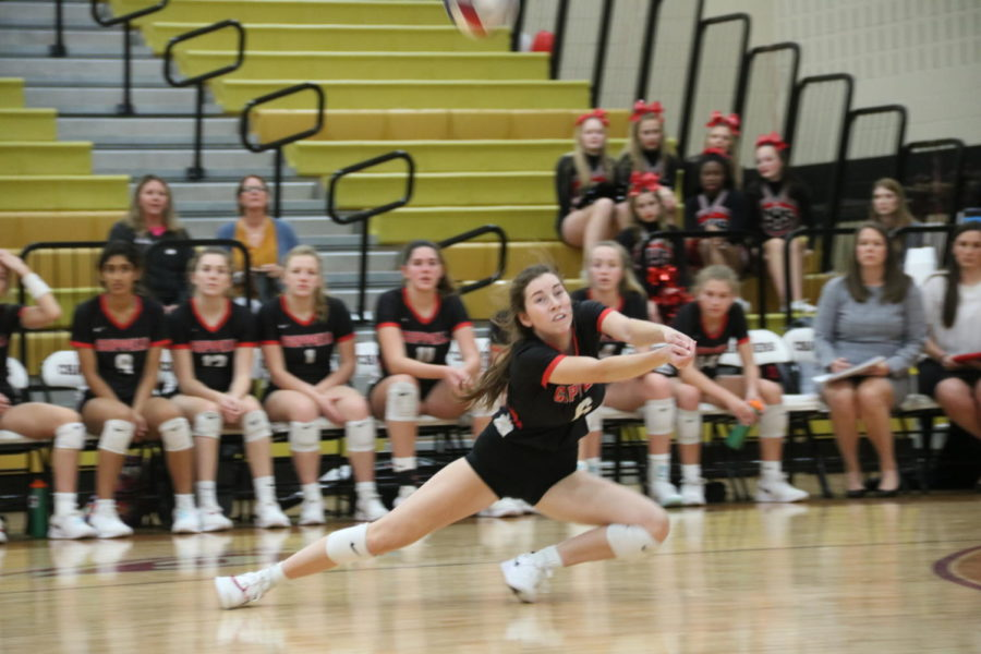 Coppell senior defensive specialist Kaylee Cloutier digs during the Class 6A Region I bi-district playoff match against Byron Nelson on Tuesday at Keller Central. The Cowgirls fell to the Bobcats in three sets, 25-14, 25-21 and 25-11.