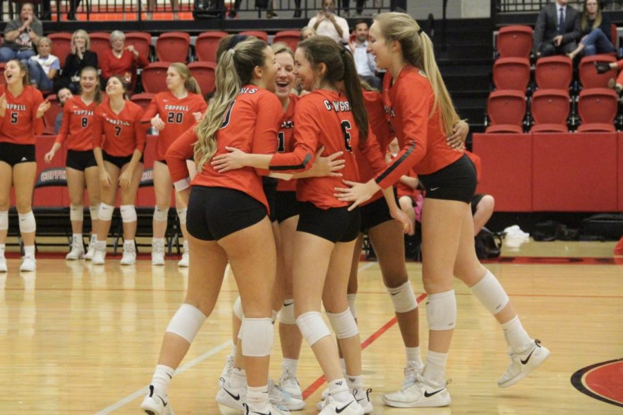 Coppell volleyball players celebrate their second set win on Senior Night in the CHS Arena on Oct. 29. The Cowgirls travel to Keller Central tonight at 6:30 to take on Byron Nelson in their Class 6A Region I bi-district playoff match.