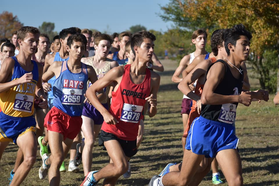 Coppell junior Evan Caswell stays at the front of the pack at the Class 6A State Meet at Old Settlers Park in Round Rock on Saturday. Caswell placed fourth overall with a time of 14:48.34 and the Coppell boys took seventh place, with the Cowgirls finishing fourth in the state. Photo courtesy Colin Proctor.