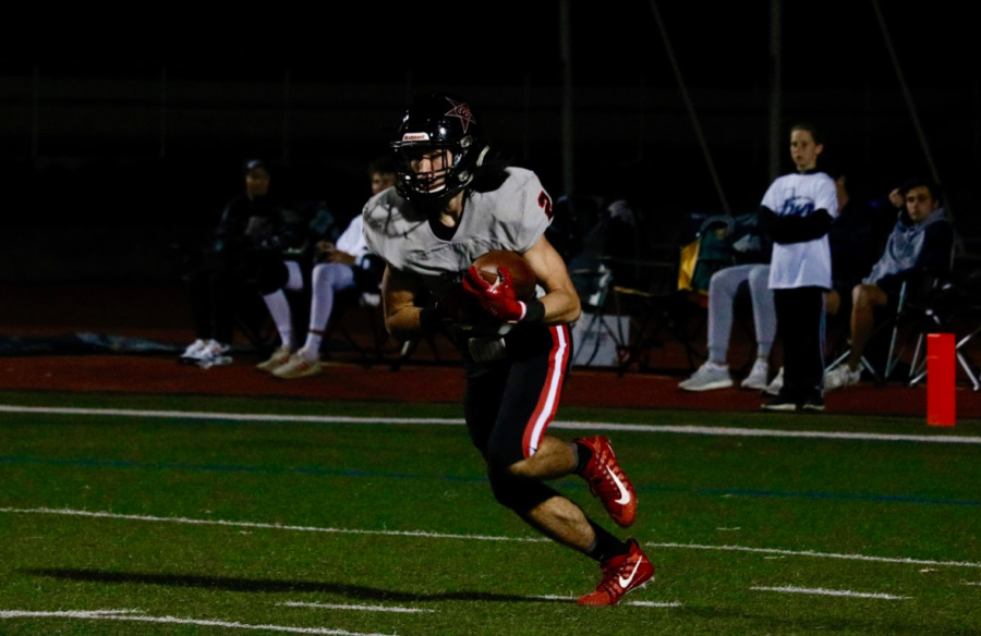 Coppell senior wide receiver Jan Rivera returns a kickoff against Flower Mound on Friday night at Neal E. Wilson stadium. The Cowboys fell, 62-47, in their sixth district game of the season, eliminating them from playoff contention.