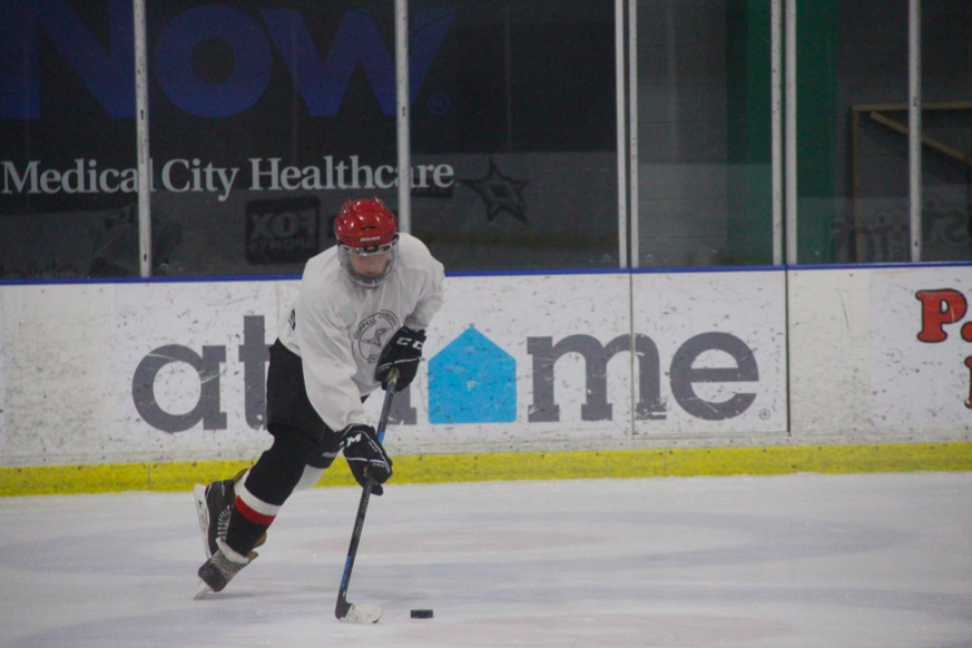 Coppell senior left wing Clark Parlier handles the puck on Oct. 28 at the Dr Pepper StarsCenter in Valley Ranch. Parlier is also a captain of the Coppell varsity tennis team while balancing school work.