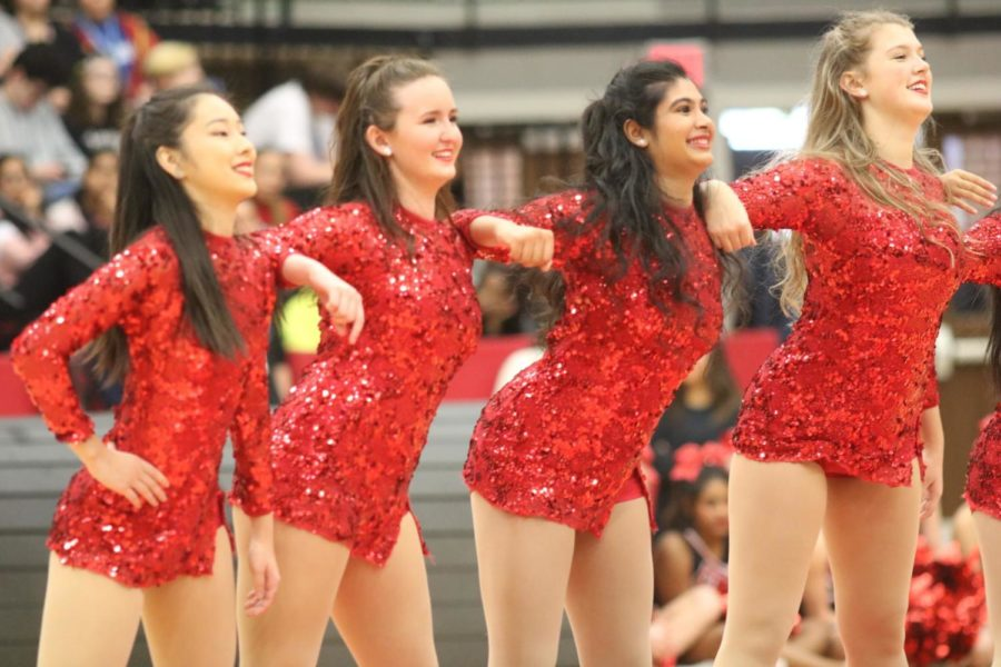 CHS+Lariette+seniors+Irene+Son%2C+Emma+Strong%2C+Maya+Mohan+and+Gillian+Perry+perform+their+senior+show+at+the+final+pep+rally+of+the+year.+The+pep+rally+was+conducted+to+engage+the+audience+for+the+last+football+game+of+the+season.