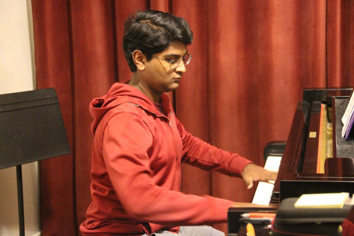 Coppell High School sophomore Joseph Mathew practices Chopin's Fantaisie Impromptu Op. 66 at the home of his piano teacher, Hwa Lee, on Nov. 8. Mathew performed this piece at Carnegie Hall in New York City on Dec. 14.