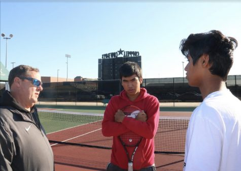 Coppell tennis coach Rich Foster advises doubles teammates junior Matthew Abbey and sophomore Vinay Patel at the CHS Tennis Center on Thursday. Foster is preparing the team for the spring season with practices and socials to build camaraderie between old and new players. Photo by Camden Southwick