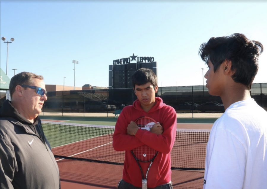 Coppell+tennis+coach+Rich+Foster+advises+doubles+teammates+junior+Matthew+Abbey+and+sophomore+Vinay+Patel+at+the+CHS+Tennis+Center+on+Thursday.+Foster+is+preparing+the+team+for+the+spring+season+with+practices+and+socials+to+build+camaraderie+between+old+and+new+players.+Photo+by+Camden+Southwick