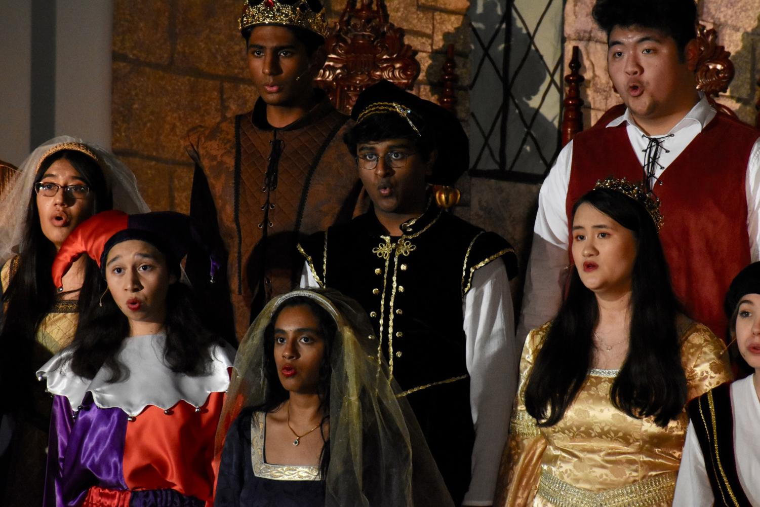 """Coppell High School Madrigal singers harmonize together during their show """"The Perfect Lie"""" last night in the CHS Commons. Every year the choir hosts a Madrigal Feast show which attracts many students, teachers, and parents to come and watch and enjoy a meal."""
