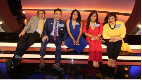 (Left to right) Family members: Trey Bautista, Ryne Bautista, Leana Funa, Cottonwood Creek Elementary fourth grade teacher Krixia Funa and Mintee Bautista sit together on the set of Family Feud in Los Angeles. Krixia Funa and her family appeared on the famous game show and won a $42,000 cash prize and Jeep.