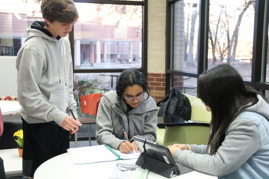 Coppell+High+School+juniors+Joshua+Brock+and+Swetha+Tandri+and+senior+Jane+Kim+discuss+homework+during+Learning+Lab+after+school+Tuesday+in+the+CHS+library.+Learning+Lab+is+run+by+Red+Jackets+and+National+Honors+Society+to+provide+free+tutoring+for+students+before+and+after+school+from+Tuesday+to+Thursday+every+week+in+the+library.
