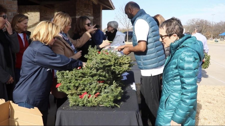 Members of the Coppell Republican Women's Club hand out wreaths during the wreath laying ceremony on Saturday.. The wreath laying ceremony was held to honor veterans buried at the Rolling Oaks Memorial Center.