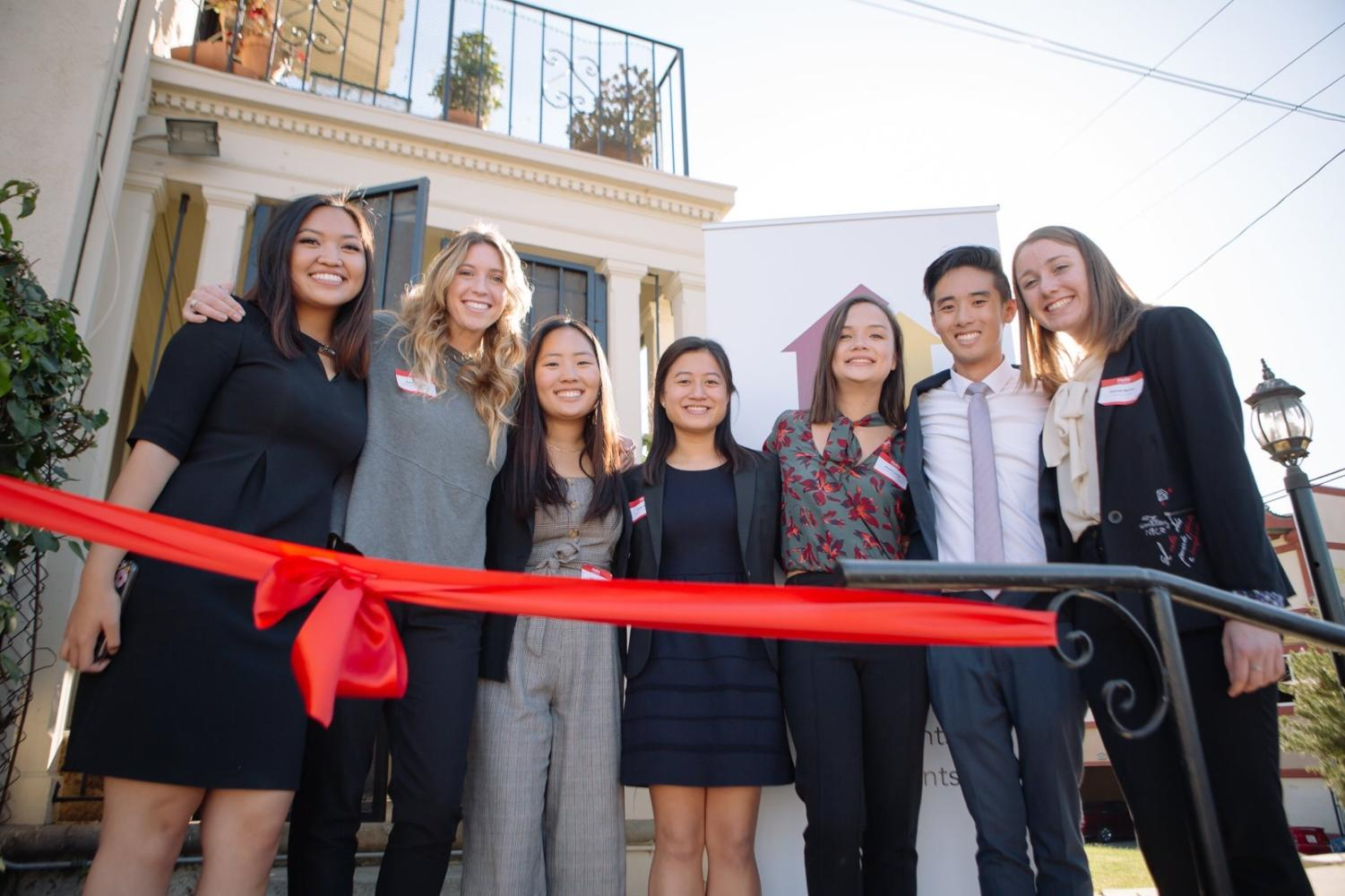 Macey Ibalio, Emma Dessau, Esther Cha of Coppell, Cathy Wang, Abigail Leung, Matthew Lee and Hannah Mulroe celebrate the opening of the Trojan Shelter on Nov. 1. The Trojan Shelter is a student run homeless shelter serving those attending the University of Southern California.