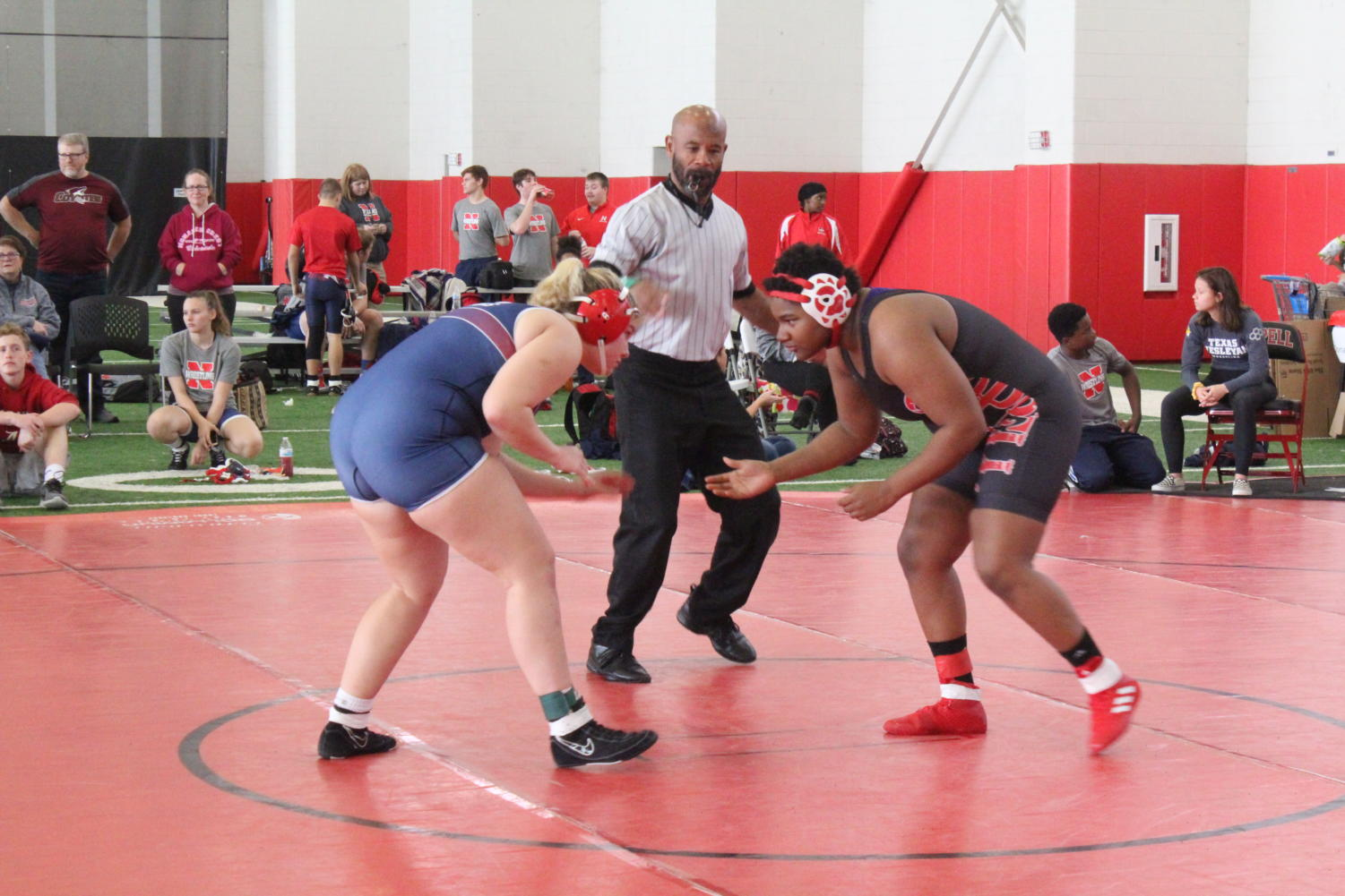 Coppell junior wrestler Hannah Francis prepares to wrestle her opponent during the Coppell Round-Up on Nov. 23. Francis has been wrestling for the school team for two years and holds three All-American titles.