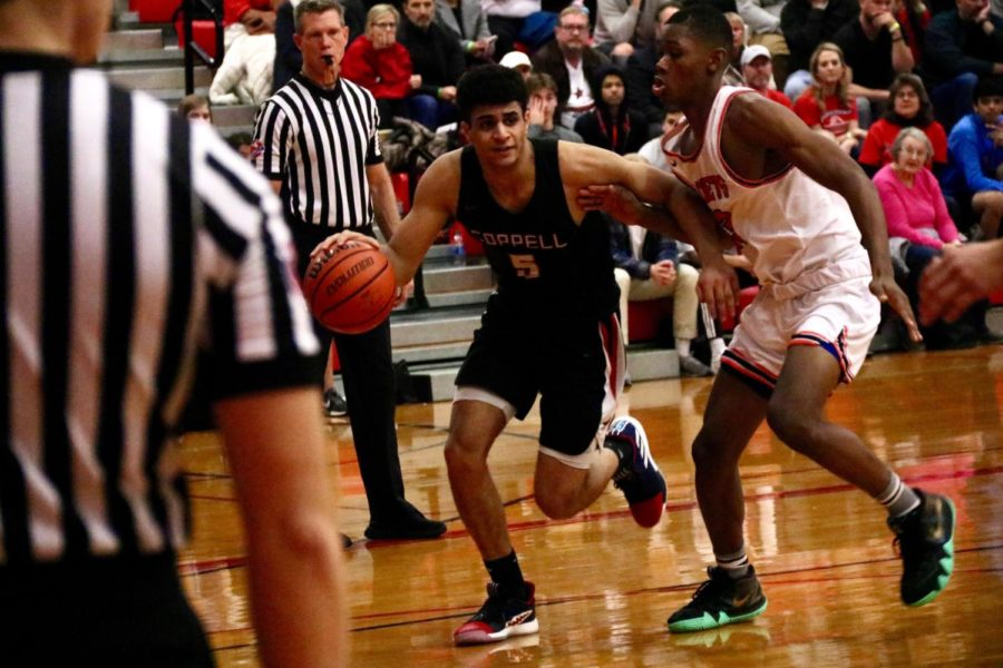 Coppell+senior+guard+Adam+Moussa+dribbles+around+a+Rockwall+defender+on+Nov.+22+during+the+Classic+Chevrolet+Showcase+in+the+CHS+Main+Gym.+Moussa+comes+from+a+family+of+basketball+players+and+is+pursuing+a+future+with+the+Egyptian+national+team%2C+carrying+the+legacy+of+his+father+and+older+siblings.