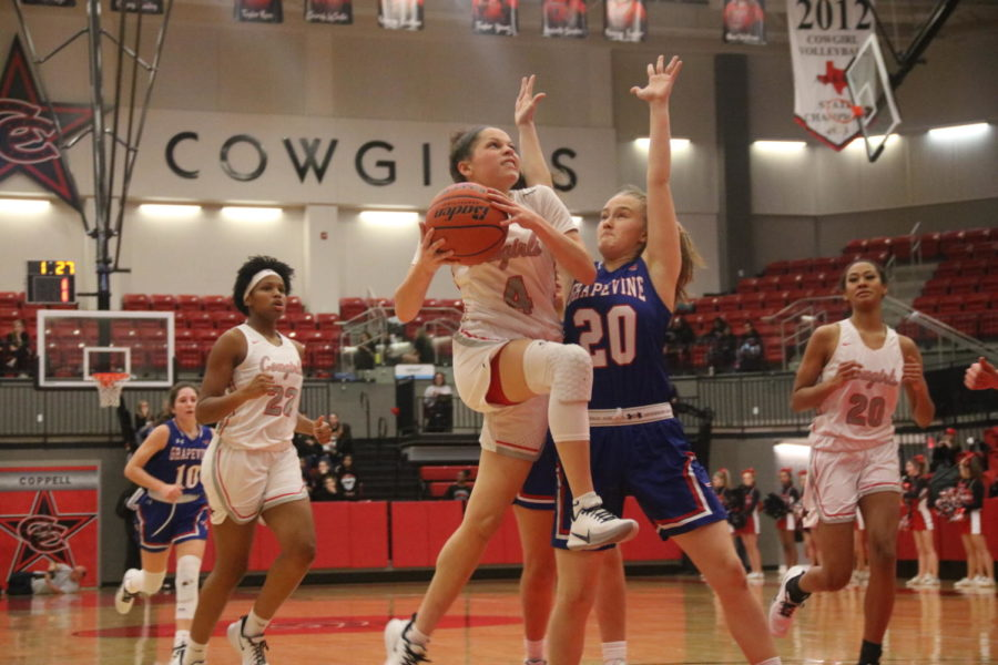 Coppell senior guard Kennedi Rogers makes a lay up in the Coppell High School Arena on Tuesday. Coppell Cowgirls defeated Grapevine Lady Mustangs, 61-42.