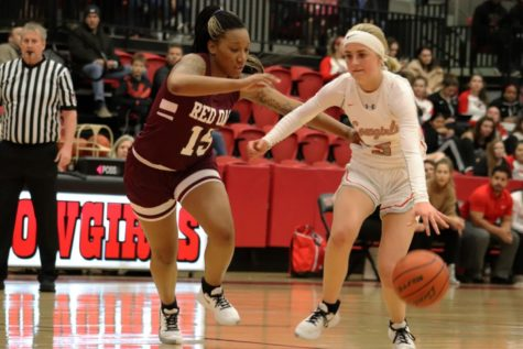 Coppell senior Jordan Nelson shields her defender on her way to the basket on Nov. 12 at the Coppell High School Arena against Red Oak. Nelson committed to Trinity University in San Antonio to play basketball next year.
