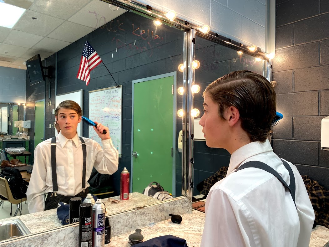 "CHS9 student Jude Taylor prepares to perform in the Coppell High School fall musical ""Newsies"" on Nov. 10. Taylor has spent his freshman year finding new beginnings, having moved to Coppell from England two years ago."