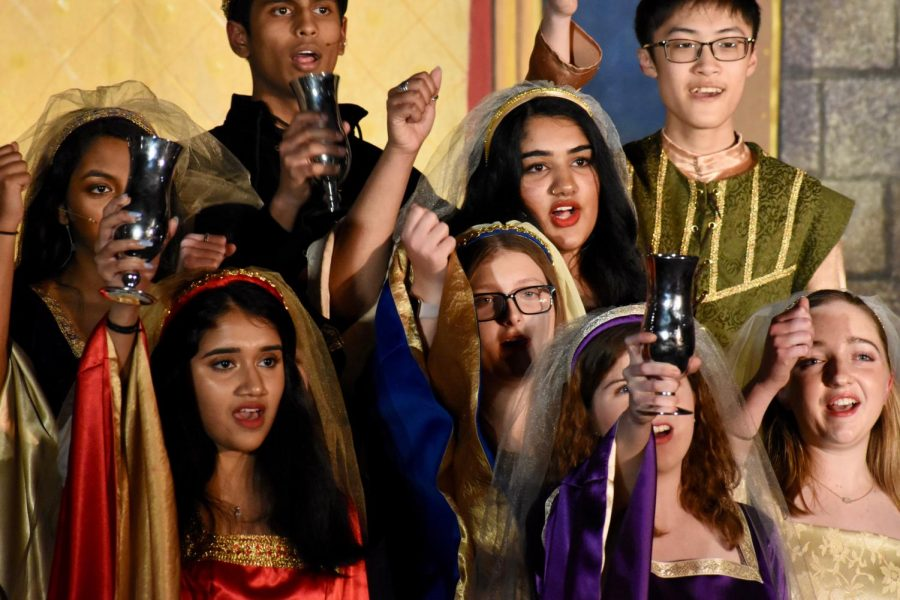 """Coppell High School Madrigal singers chant together during their show, """"The Perfect Lie"""" on Dec. 6 in the CHS Commons. Every year the choir hosts a Madrigal Feast show which attracts many students, teachers and parents to come and watch and enjoy a meal."""