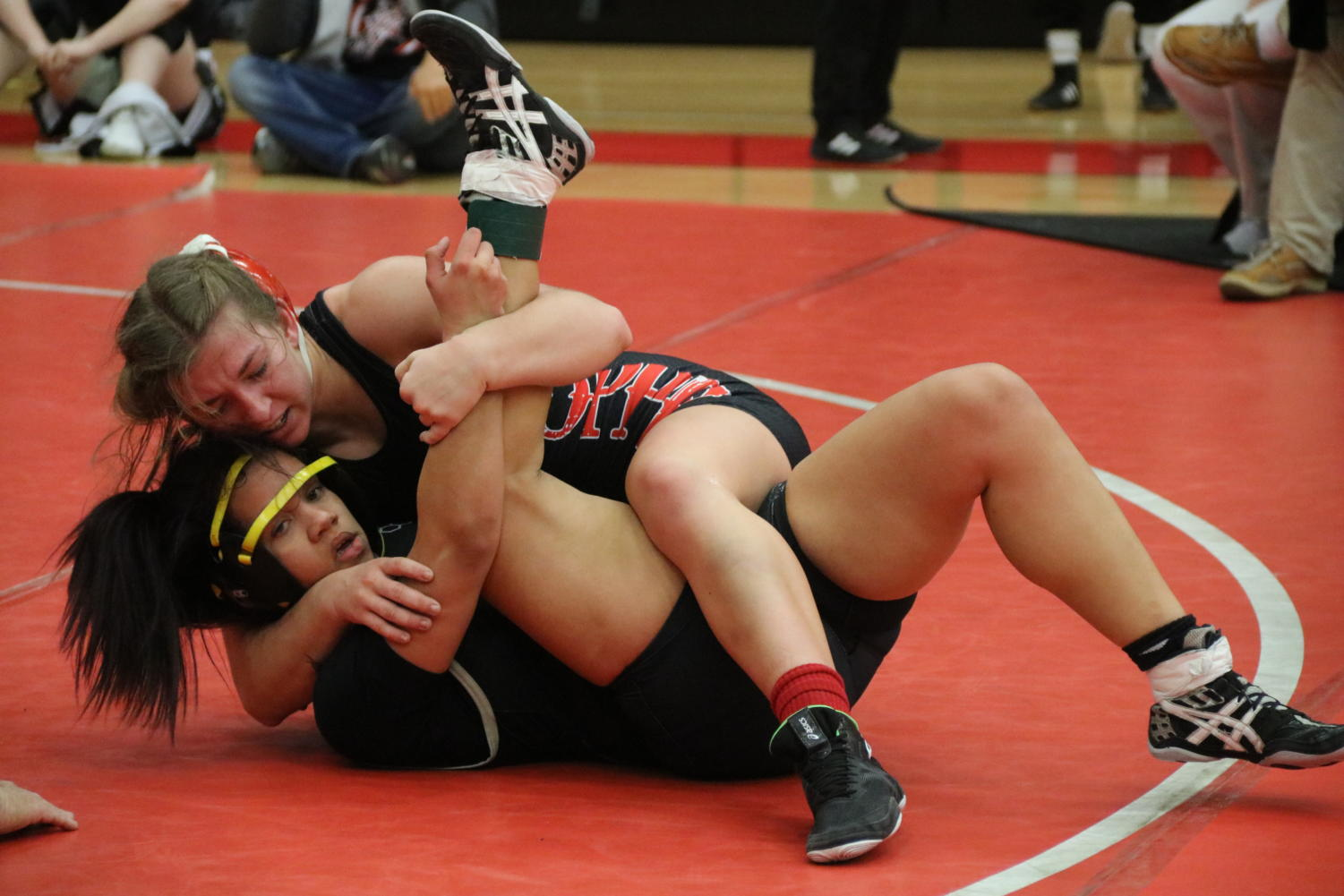 Coppell senior Brooke Massaviol tries to pin junior Kiya Tillery from The Colony. The Cowgirls placed first overall in the Knockout Sportswear Cowgirl Classic on Friday in the CHS Arena.