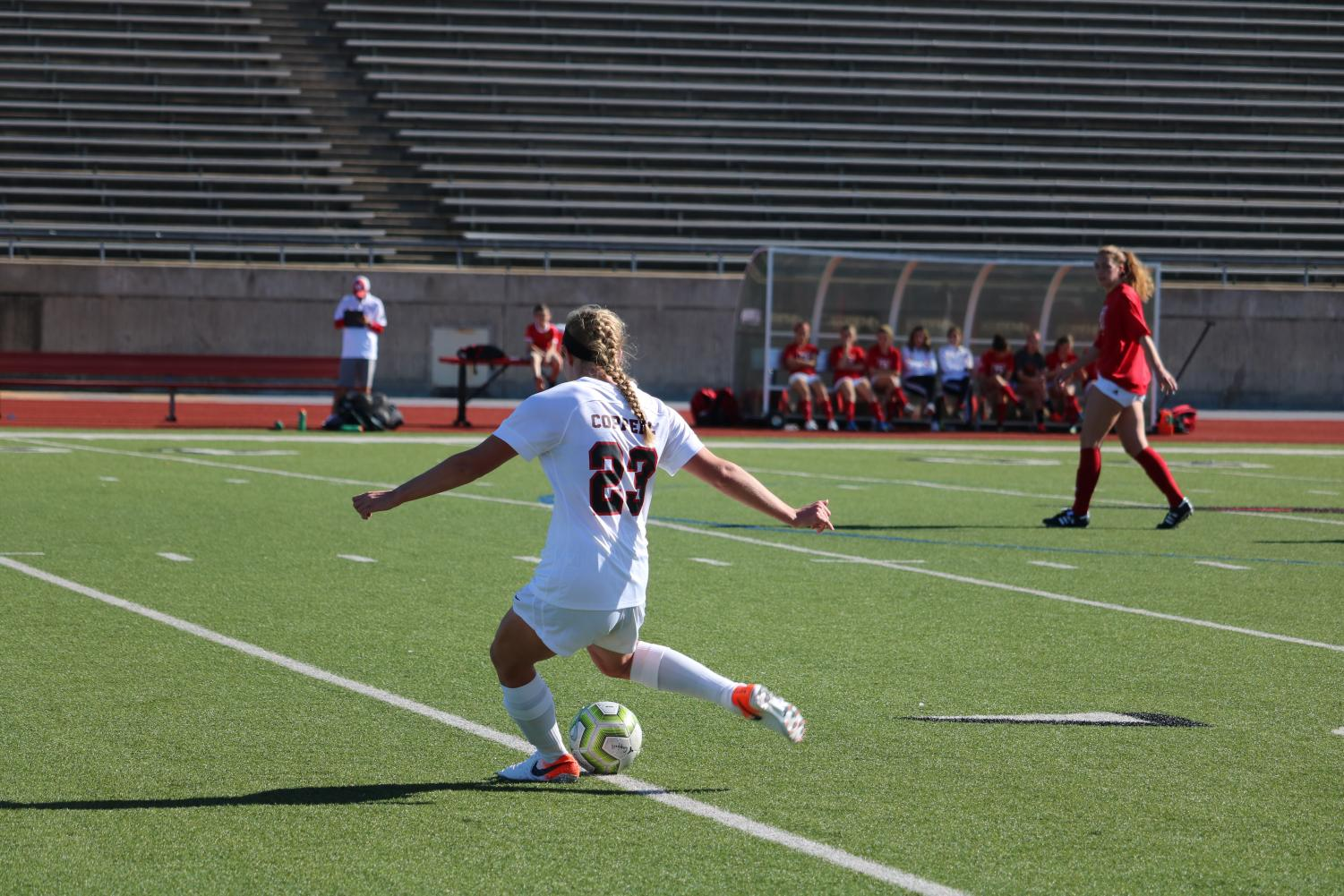 Coppell sophomore defender Bailey Peek crosses a free kick into the box on Saturday at Buddy Echols Field. The Coppell Cowgirls defeated the Lady Tigers, 2-0.