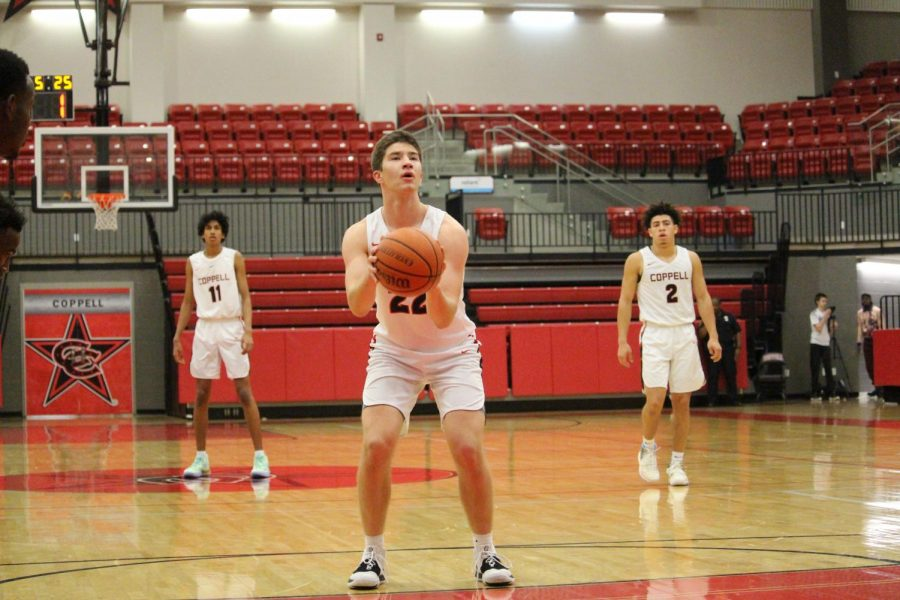 Coppell senior forward Dan Igrisan attempts a free throw in the CHS Arena on Tuesday against Mesquite. The Cowboys play Timber Creek tomorrow in the CHS Arena at 8 p.m.
