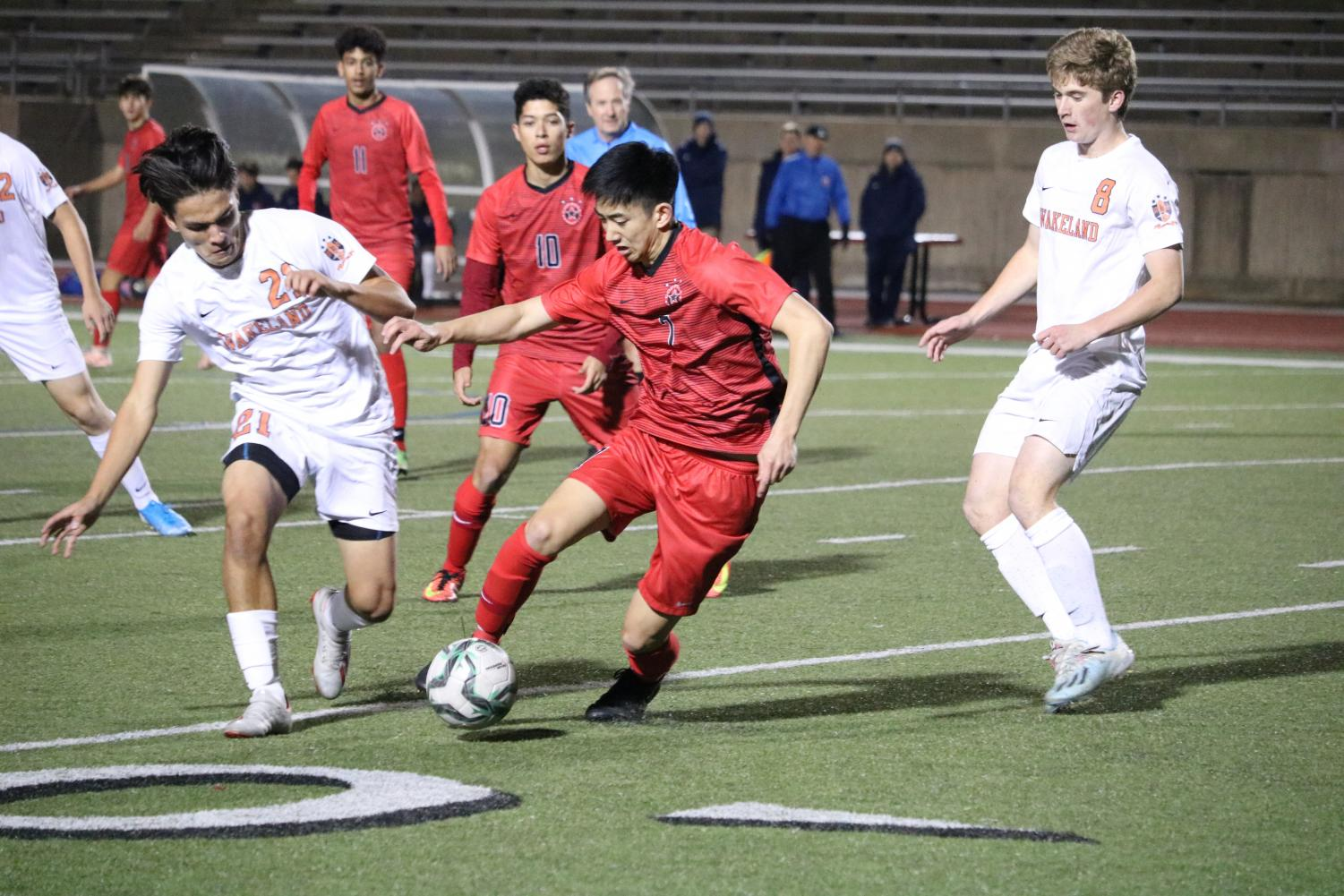Coppell senior midfielder Ben Wang fights for possession with Frisco Wakeland's Juan Ardila during the scrimmage on Thursday at Buddy Echols Field. The Cowboys defeated the Class 5A runners-up, 4-3, on a free kick.